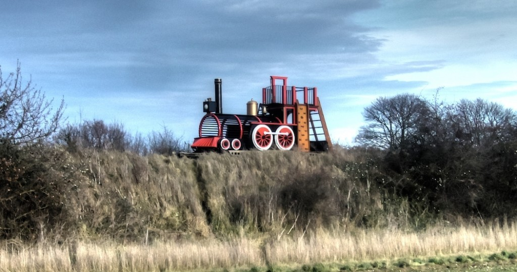 Across the field shot (Pacific Locomotive children's wooden play train with fireman's pole and climbing wall)