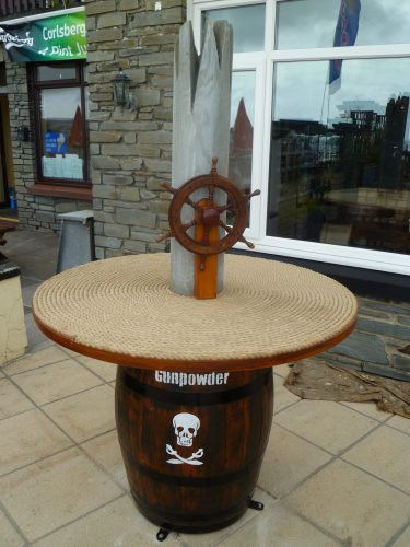 Barrel And Ship Wheel Table Smuggler Bar And Grill Amroth Pirate Themed Seating And Benches