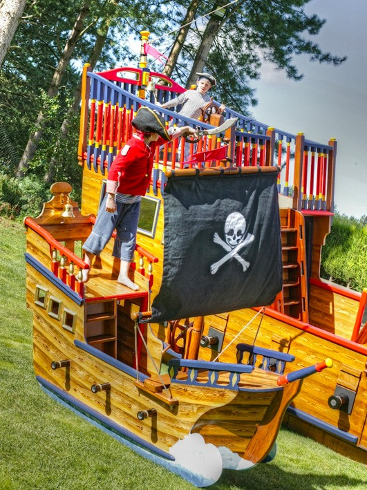 Child Pirate War Between Miniature Play Pirate Ship And Pirate Galleon