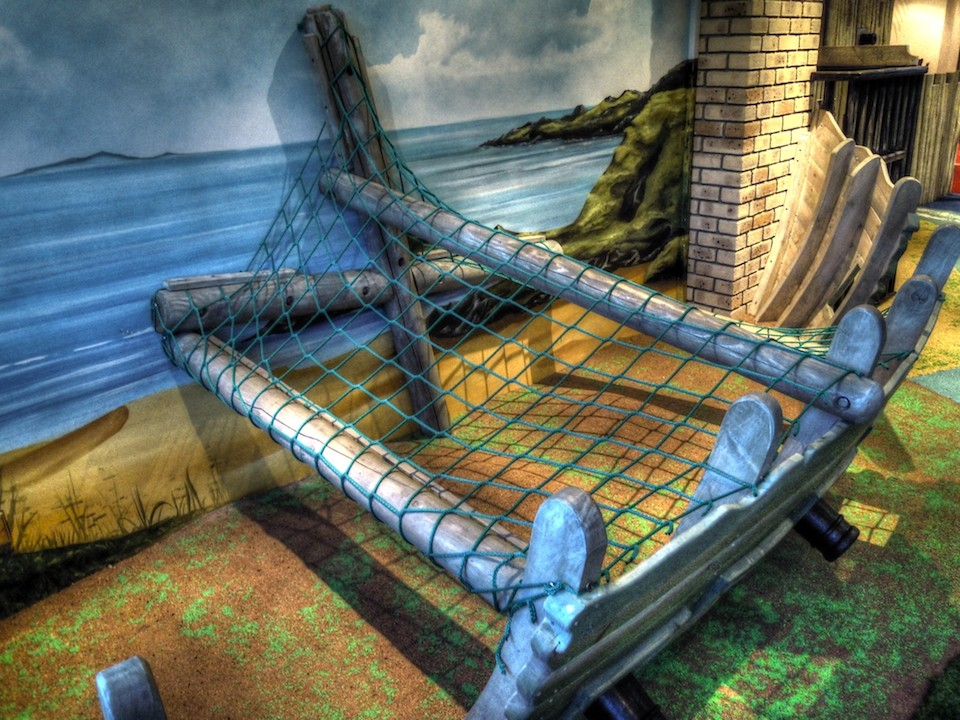 Climbing net (Smuggler's Bar and Grill restaurant indoor children's play area pirate themed with climbing ropes and slide)