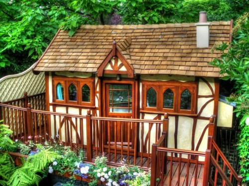 Front Right View Ariana Childrens Wooden Play House Playhouse In A Uk Private Garden With Fully Furnished Interior Including Heating Electrics Kitchen Beds
