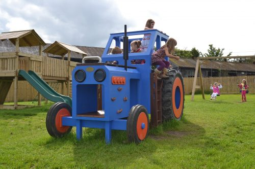Front with kids (Children's blue wooden tractor with slide)