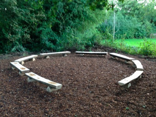 Seating Rustic Split Log Benches Bench By Flights Of Fantasy Arranged In A Circle In Woodland