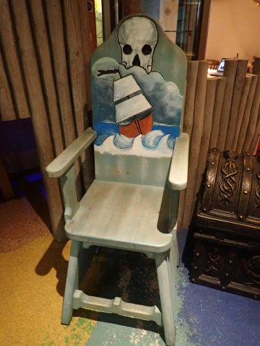 Ship And Skull Pirate Themed Seating Chairs For Smugglers Bar And Grill By Flights Of Fantasy E1482244310352