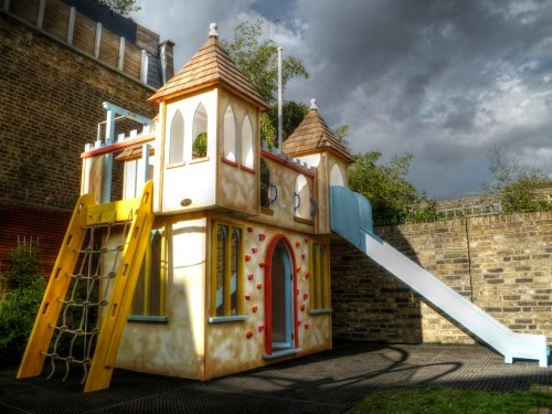 Side View With Climbing Net Climbing Wall And Slide Waterslide Wooden Play Castle