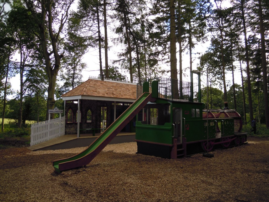 slide-at-rear-childrens-play-area-replica-gwr-steam-train-and-station-at-wallington-hall
