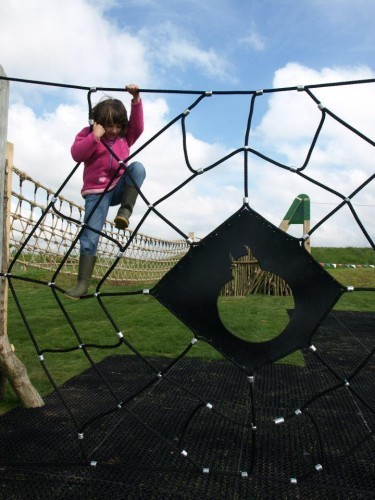 Spider Web Climb Net With Child Abberton Reservoir Childrens Outdoor Play Area By Flights Of Fantasy