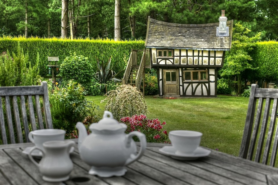 Tea set forground at the back of the garden (Tudor House wooden childrens playhouse wendy house for Jamie)