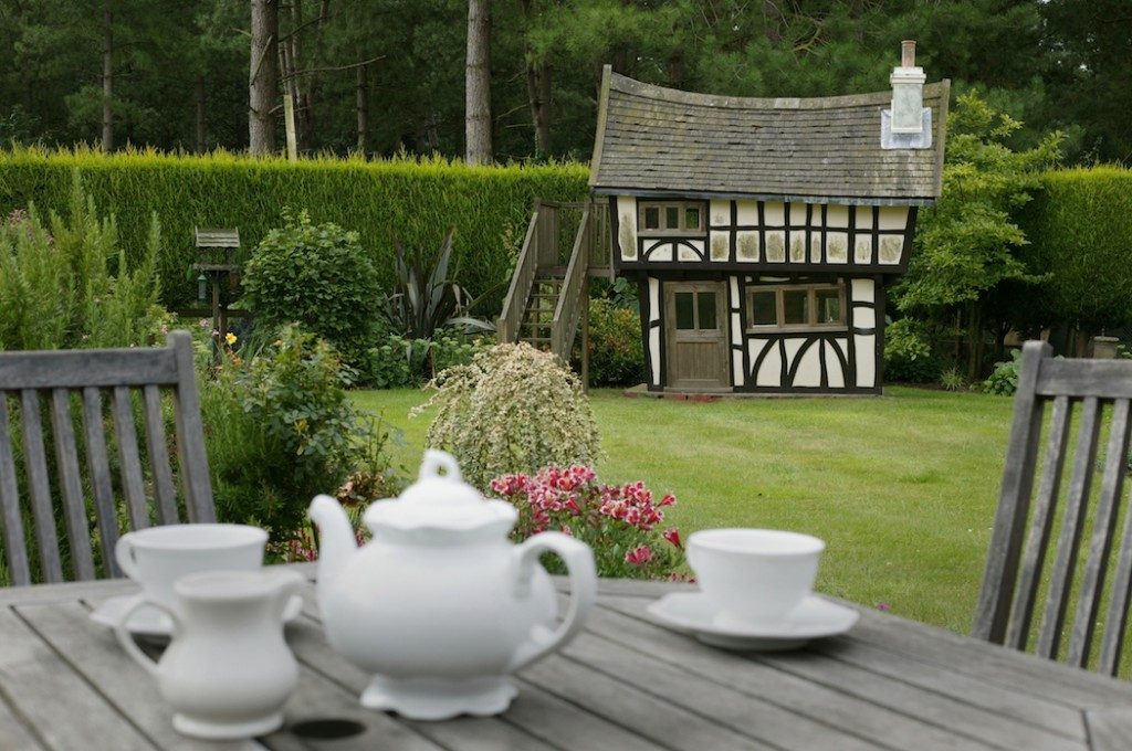 Tea Set Forground At The Back Of The Garden Tudor House Wooden Childrens Playhouse Wendy House For Jamie1