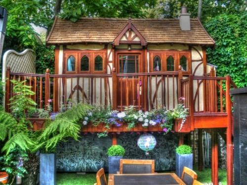 View at the back of the garden (Ariana children's wooden play house : playhouse in a UK private garden with fully furnished interior including heating electrics kitchen beds)