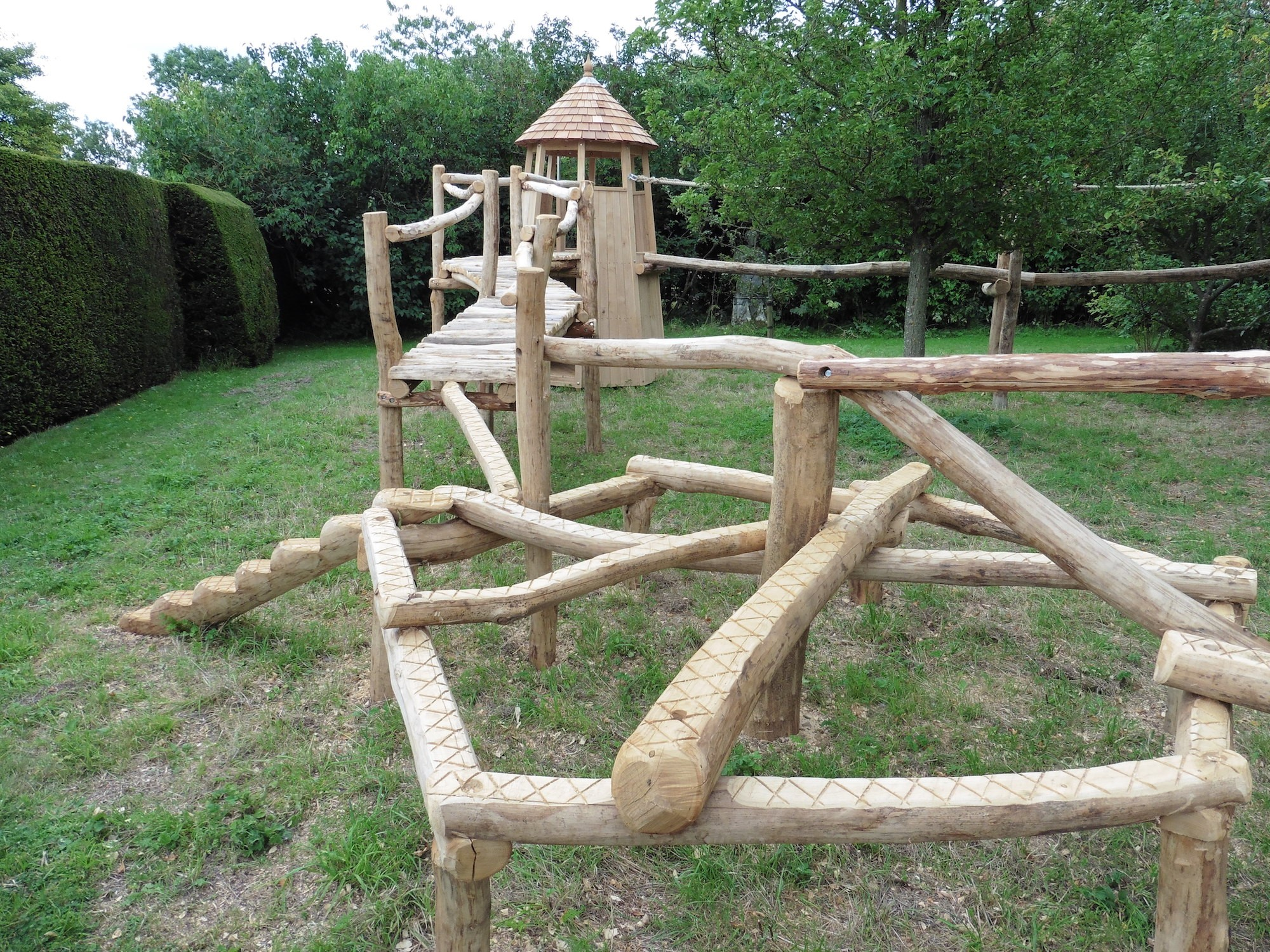 balance games in rustic garden adventure trail